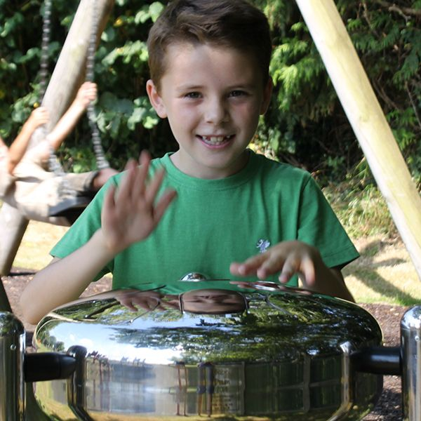 Boy Playing Stainless Steel Tongue Drum in Playground
