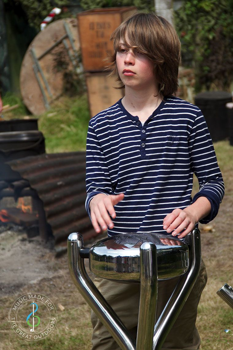 Teenage Boy Playing Stainless Steel Outdoor Tongue Drum