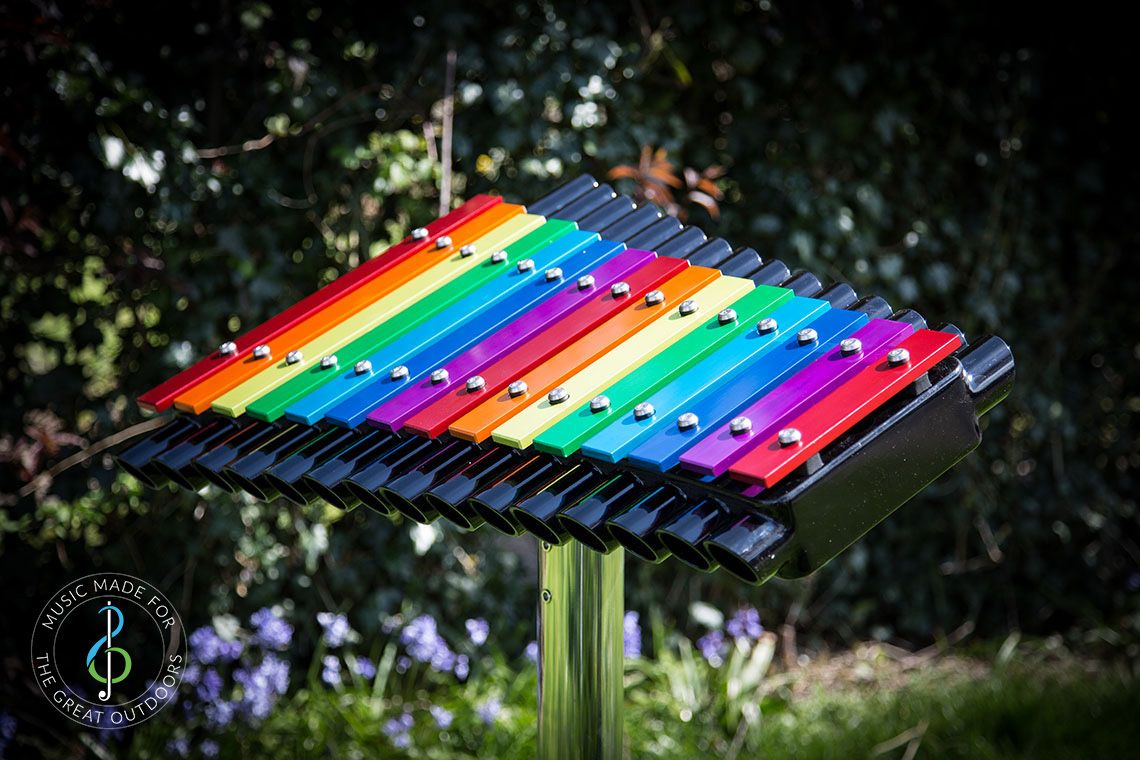 Large Xylophone with Rainbow Coloured Notes Outdoors in the sun