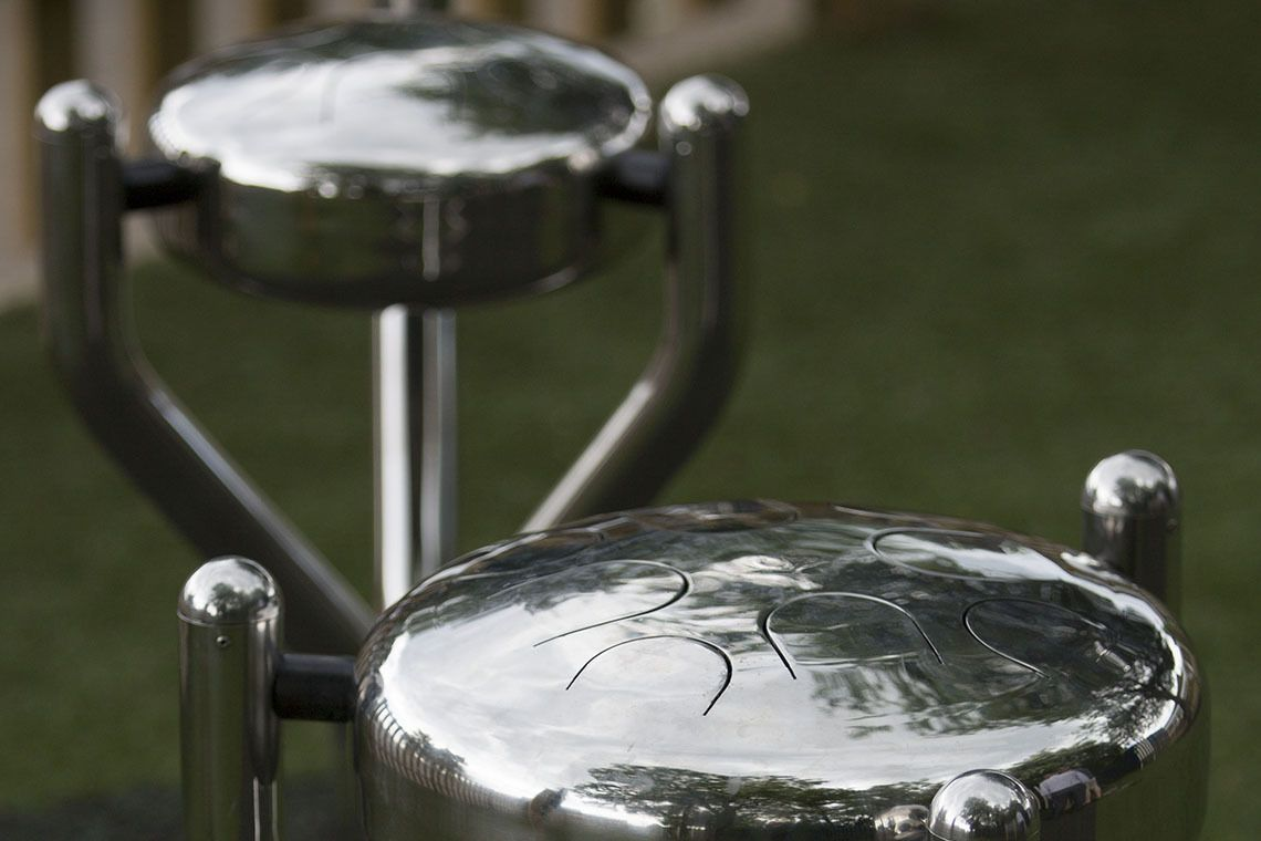 Two stainless steel tongue drums installed in a playground