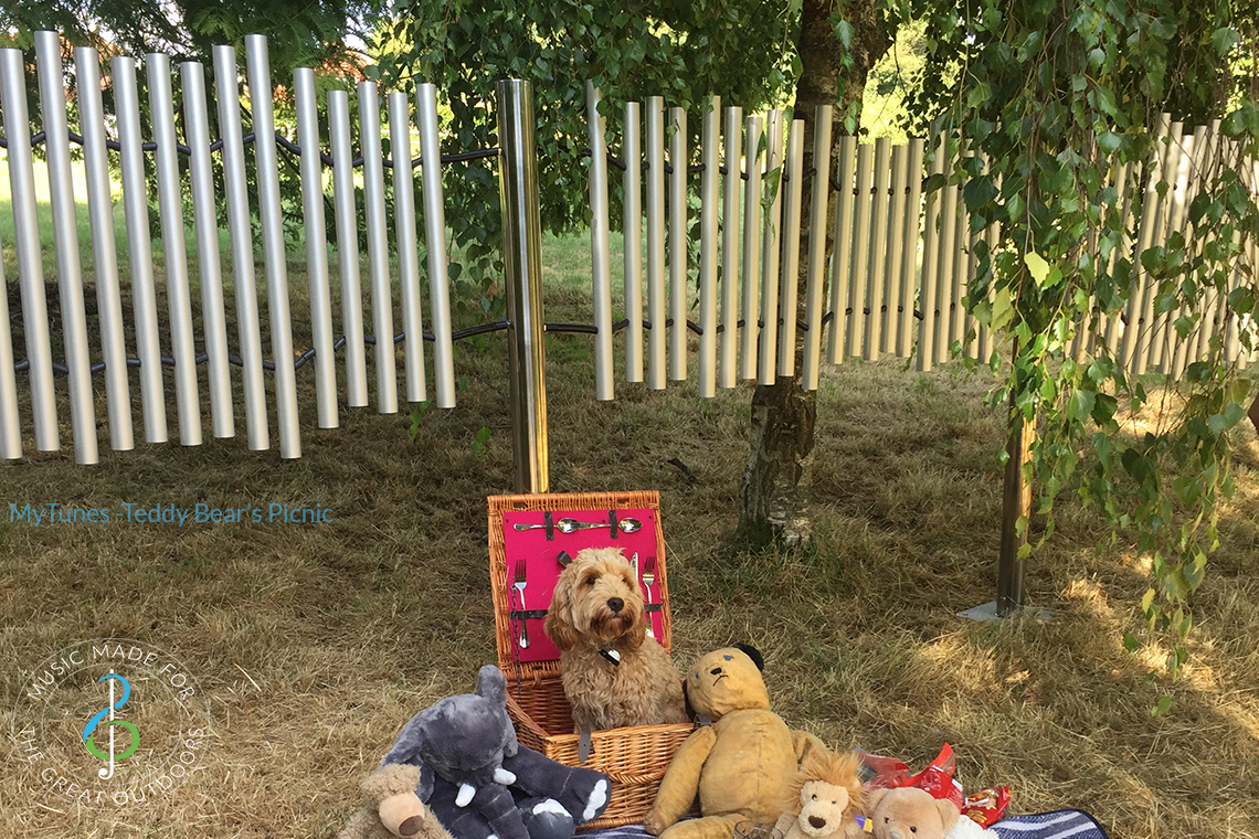outdoor musical chime set which plays Teddy Bear Picnic with a small dog and teddy bears underneath